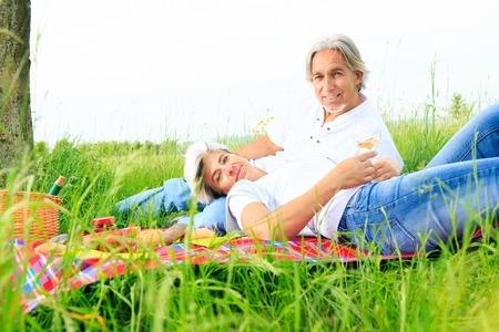 Senior Couple Having A Picnic Stock Photo