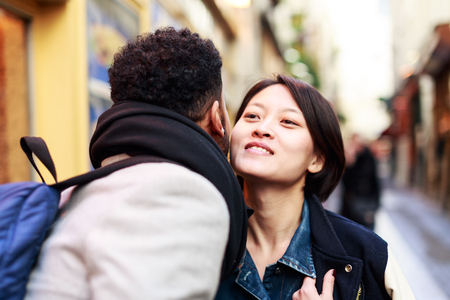 Young Adults Kissing In The Streets Of Paris 写真素材