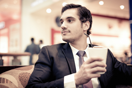 Businessman Sitting In A Cafe Stock Photo