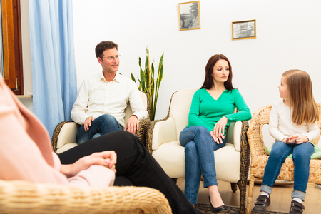 Family Seeing A Psychotherapist Stock Photo