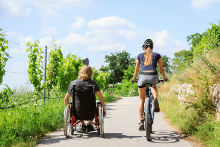 Young Couple In Wheelchair Enjoying Time Outdoors Stock Photo - 70671711