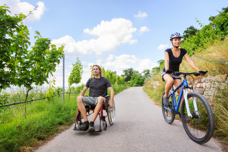 impaired: Young Couple In Wheelchair Enjoying Time Outdoors