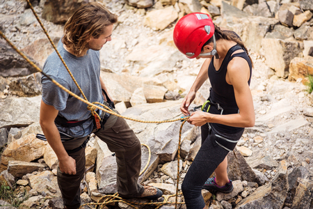 Young Climbers Checking Equipment Stock Photo
