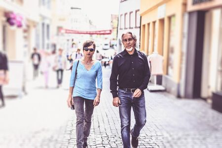 walking zone: Senior Couple Walking Through The Streets Of Tuebingen Stock Photo