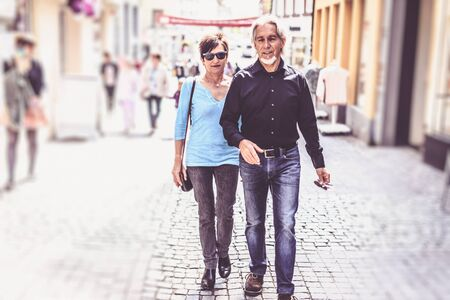 sight seeing: Senior Couple Walking Through The Streets Of Tuebingen Stock Photo