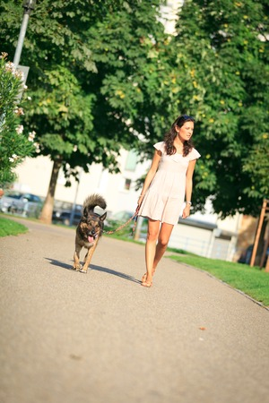 sch: Woman With Her Dog In The Park