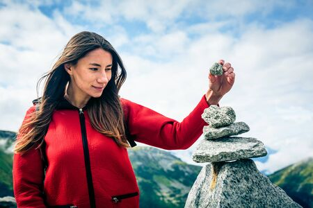 standing stone: Young Woman At The Top Of The Mountain
