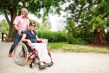 age 60: Senior Couple In Wheelchair