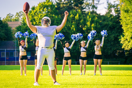 American Football Player With Cheerleaders