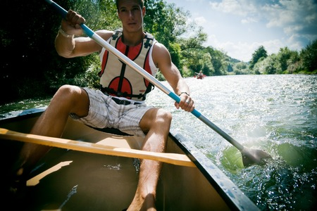 Young Man Canoeing Stock Photo