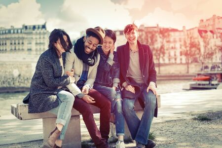 sight seeing: Multi-ethnic Group Of Friends Having Fun In Paris Along Seine Stock Photo