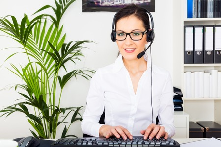 providing: Young Woman Providing It Support Stock Photo