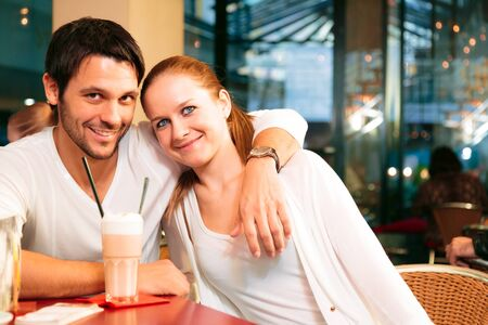 Couple Having A Good In Cafe Stock Photo