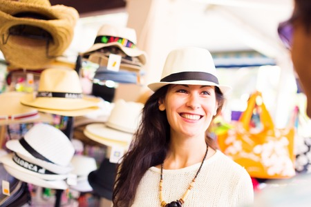 sunhat: Tourists Shopping For A Sunhat Stock Photo