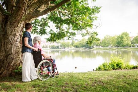 impaired: Senior Couple In Wheelchair