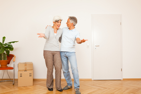 relocate: Senior Couple Moving Into A New Apartment Stock Photo