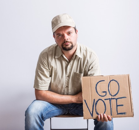 truck driver: Truck Driver Holding Go Vote Sign