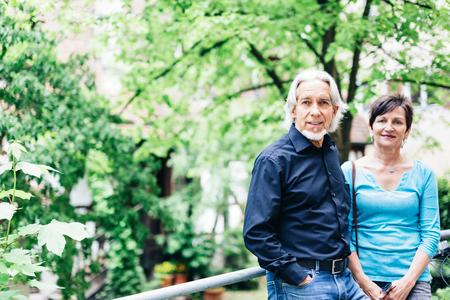 Senior Couple Walking Through Park Stock Photo