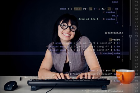 Female Nerd Programming Stock Photo