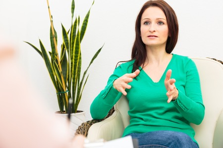 Woman Seeing A Psychotherapist Stock Photo
