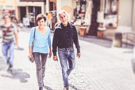 Senior Couple Walking Through Tuebingen, Germany Stock Photo
