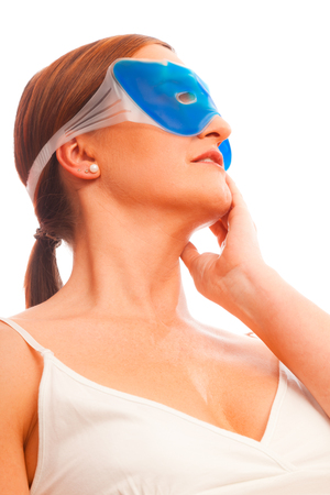 Anti-ageing Concept: Woman In Her Forties With Cooling Mask