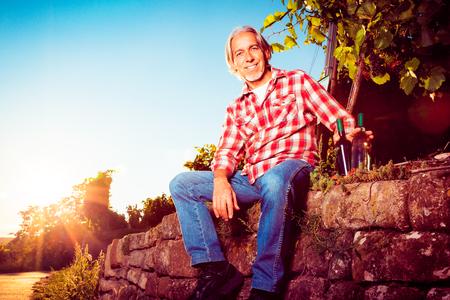 Winemaker Sitting By His Vineyard Stock Photo