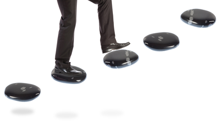 Businessman On Stepping Stones