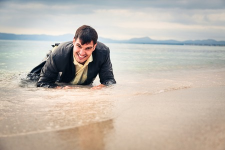 Businessman Crawling To Safety Stock Photo