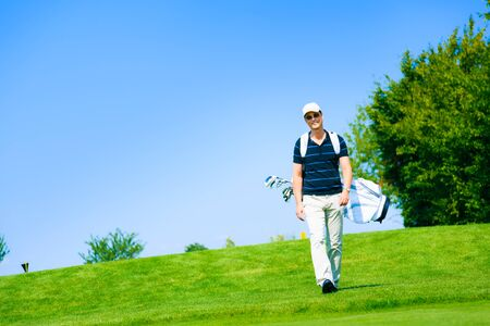 Man Walking To His Golf Ball Stock Photo