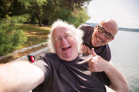 Old Man In Wheelchair Taking A Selfie