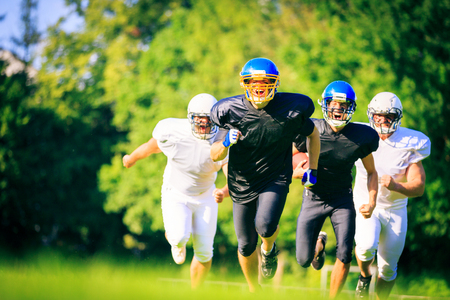 American Football Players Running
