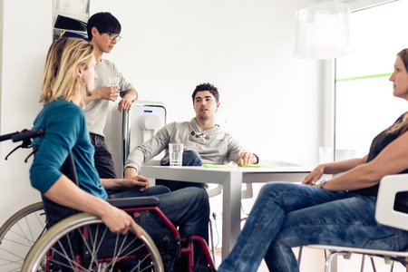 physical impairment: Office Workers Taking A Break. Stock Photo