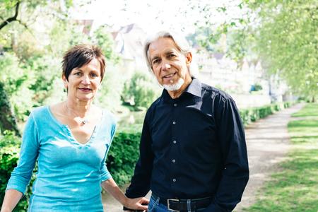 Senior Couple Walking Through A Park