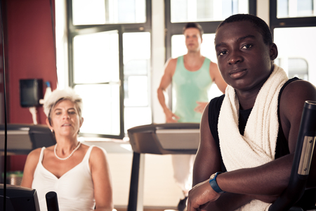 ethnically diverse: Young And Mature People At The Gym