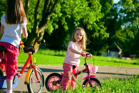 Two Little Girls On Bicycles