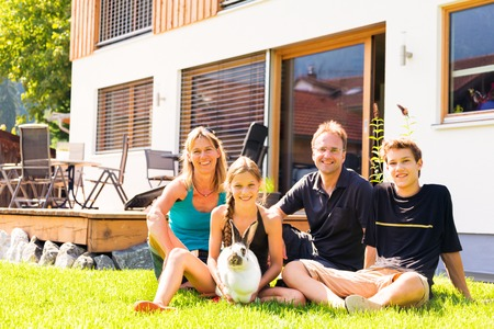 Family Of Four In Their Back Yard Stock Photo
