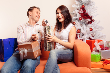 stock photo young couple exchanging christmas gifts