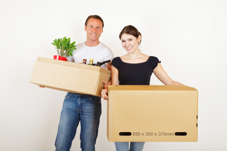 moving box: Young Couple Moving In Together