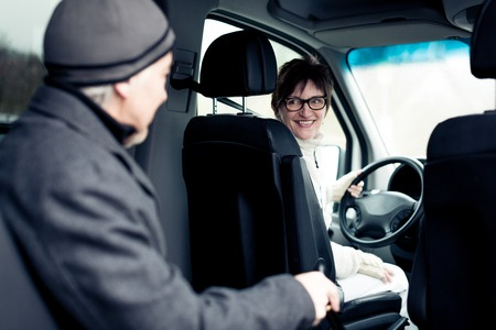 Senior Man Sitting In Paratransit Van Stock Photo