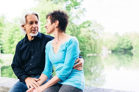 Senior couple relaxing by the lake, Tuebingen, Germany Stock Photo