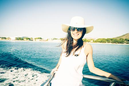 mallorca: young woman on boat, enjoying summer vacations