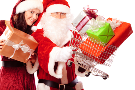 Mr And Mrs Santa Claus Shopping For Gifts Stock Photo