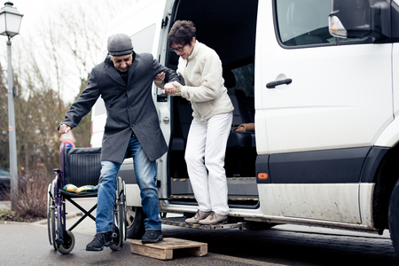 Nurse Helping Senior Man Exit A Van Stok Fotoğraf