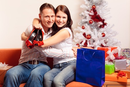 young couple exchanging christmas gifts stock photo picture and royalty free image image 88629644
