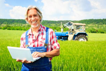 Farmer Standing In A Field
