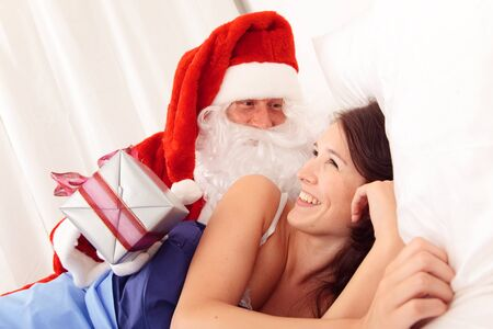 Young Beautiful Woman Being Woken Up By Santa Claus
