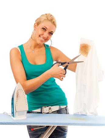 Young Woman cutting a burned shirt