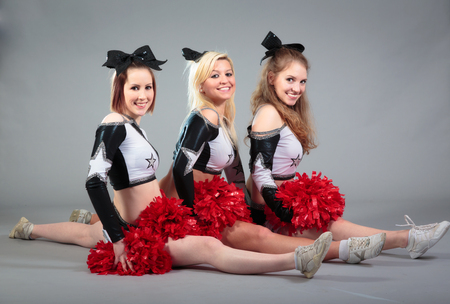 Three Cheerleaders Doing The Splits