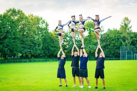 Cheerleader Team Practicing Stock Photo
